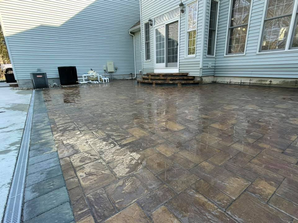 ppoolscape patio with drain